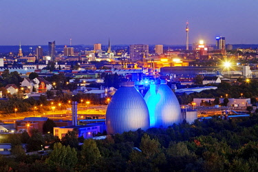 IBLSZI04365728 City view with the illuminated digesters of WWTP Dortmund Deusen II, Dortmund, Ruhr district, North Rhine-Westphalia, Germany, Europe