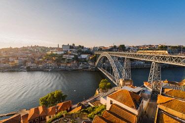 POR9915AWRF Portugal, Norte region, Porto (Oporto). Dom Luis I bridge and Douro river at sunset.