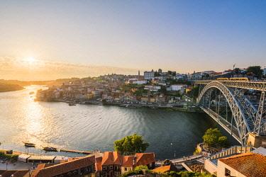 POR9917AWRF Portugal, Norte region, Porto (Oporto). Dom Luis I bridge and Douro river at sunset.