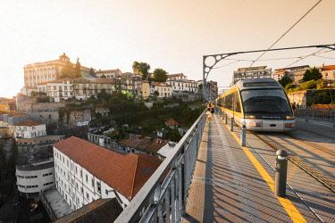 POR9862AW Portugal, Norte region, Porto (Oporto). Train passing over Dom Luis I bridge.