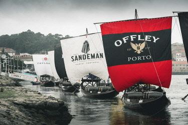 POR9868AW Portugal, Norte region, Porto (Oporto). Sailing boats showing porto wine brand names.