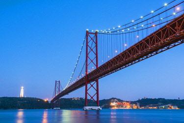 POR9883AW Portugal, Lisbon. The 25 de Abril Bridge across the Tagus river and Cristo Rei (Christ the King).