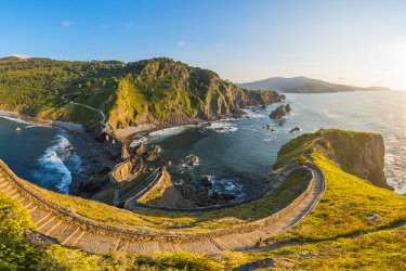 SPA8223AW Spain, Basque Country, Gaztelugatxe. Walkway to the hermitage at sunset.