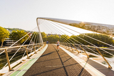 SPA8239AW Spain, Basque Country, Bilbao. Zubizuri bridge (White Bridge) across the Nervion River, designed by Santiago Calatrava.