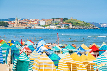 SPA8253AW Spain, Asturias, Gijon. Typical beach tents on Playa de San Lorenzo.