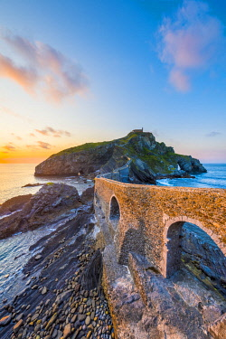 SPA8455AW Spain, Basque Country, Gaztelugatxe. Walkway to the hermitage at sunset.