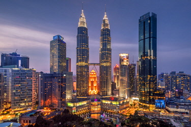 MAY0223AW City skyline at dusk, Petronas Towers, KLCC, Kuala Lumpur, Malaysia