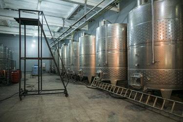 AM01284 Armenia, Switzerland of Armenia area, Ijevan, Ijevan Wine Factory, modern wine fermentation barrels