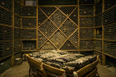 AM01286 Armenia, Switzerland of Armenia area, Ijevan, Ijevan Wine Factory, wine cellar, old wine bottles
