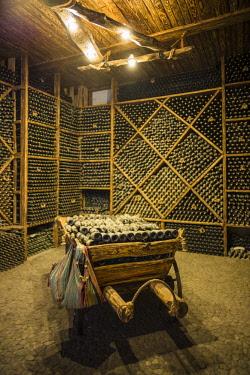 AM01287 Armenia, Switzerland of Armenia area, Ijevan, Ijevan Wine Factory, wine cellar, old wine bottles