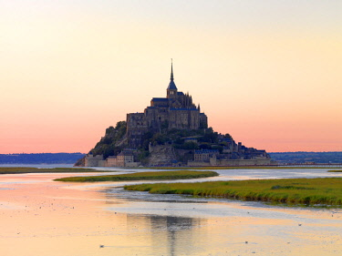 FRA10504AWRF France, Normandy, Le Mont Saint Michel reflected at dusk