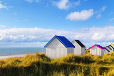 FRA10528AW France, Normandy, Gouville Sur Mer, colourful beach huts