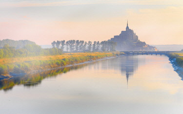 FRA10531AW France, Normandy, Le Mont Saint Michel, shrouded in fog at dawn, reflected in river