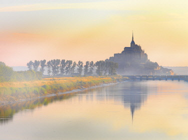 FRA10533AW France, Normandy, Le Mont Saint Michel, shrouded in fog at dawn, reflected in river
