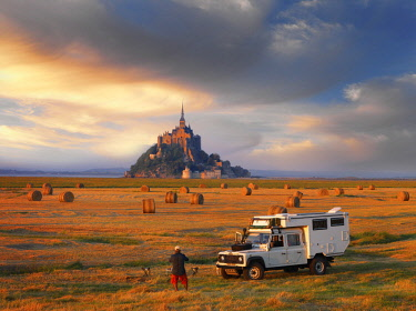 FRA10536AW France, Normandy, Le Mont Saint Michel, Man and truck in hay field