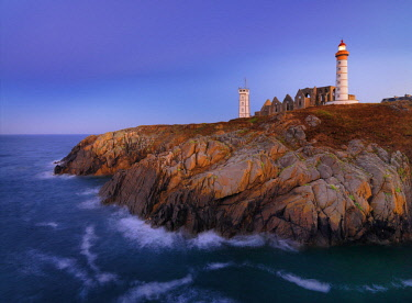 FRA10570AW France, Brittany, Finistere, Pointe St. Mathieu, Saint Mathieu lighthouse at dusk