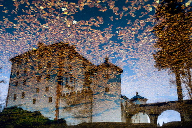 Reflection of Sne�nik Castle on autumn, Slovenia