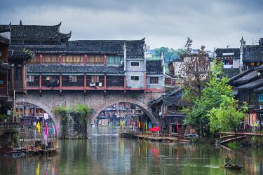 FVG033640 Sailing along Tuojiang river, Phoenix Hong Bridge or Rainbow bridge in Fenghuang ancient town, Hunan, China