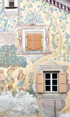 FVG034920 Detail of Chasa Clalguna, historic house with frescos representing Adam and Eve in Ardez village, a little village with painted 17th Century houses, Low Engadin, Canton of Grisons, Switzerland, Europe