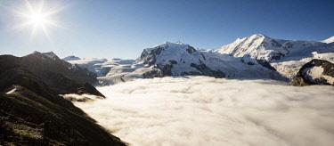 FVG035191 View from Gornergrat mountain towards Monte Rosa or Breithorn mountain range and the Gorner glacier in the fog, Zermatt, Valais, Switzerland, Europe