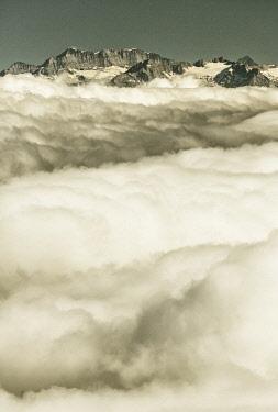 FVG035204 View from Gornergrat mountain towards the mountain of Zermatt valley in the fog, Zermatt, Valais, Switzerland, Europe