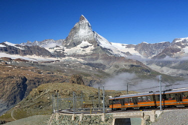 FVG035223 Gornergrat Railway with Matterhorn Mountain or Monte Cervino near Gornergrat summit station, Zermatt, Canton of Valais, Switzerland, Europe