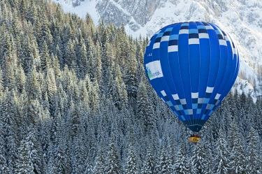 FVG035529 Hot air balloon flying over the Fiscalina valley during the balloon festival of Dobbiaco, Pusteria valley, dolomites, Trentino Alto Adige, Italy, Europe