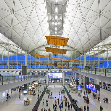 CH11672 The interior of Terminal 1 Hong Kong International Airport ( Chek Lap Kok), Designed by the Architect Norman Foster, with a replica of the 1903 Wright Brothers Flyer Aircraft hanging from the ceiling,...