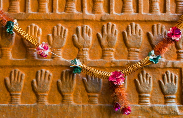 AS10AJN0054 India, Rajasthan, Jodhpur. Mehrangarh Fort (built circa 1460 on National Geological Monument, part of the Malani Igenus Suite in Thar Desert region), wall frieze of hands, with necklace
