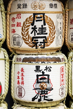 AS15MGL0036 Kobe, Japan. Barrels of Sake wrapped in straw at the entrance to Ikuta Jinja Temple, as an offering
