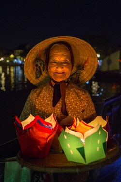 AS38TNO0357 Old lady selling candle floats, Hoi An. Tet Festival, New Year celebration, Vietnam. (MR)
