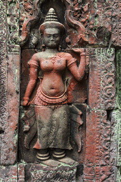 AS40MGL0054 Siem Reap, Cambodia. Stone reliefs depicting a Devata, a female spirit guardian of Hindu and Buddhist mythology on the walls of the Bayon Temple in Preah Khan