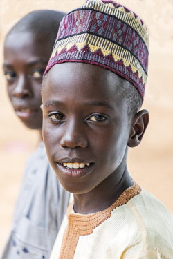 NGR1029 Nigeria, Kano State, Kano. Two young Hausa boys in Islamic dress.