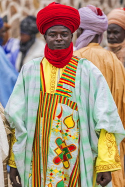 NGR1062 Nigeria, Kano State, Kano. A Hausa man dressed in large flowing, embroidered robe and a vivid red turban.