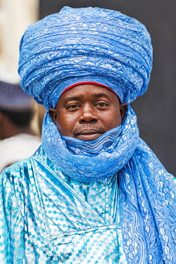 NGR1066 Nigeria, Kano State, Kano. A Hausa man dressed in turquoise with an elaborate blue turban.