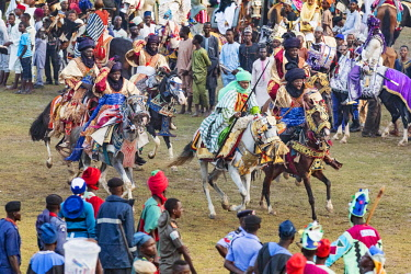 NGR1123 Nigeria, Kano State, Kano. At the conclusion of a Durbar parade, horsemen gallop up to the Emir of Kano to display their horsemanship and pay him their respects.