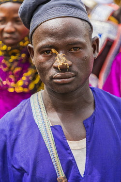 NGR1140 Nigeria, Kano State, Kano. A Hausa youth with a scorpion on his nose during a Durbar celebration.  He displays it as sign of his fearlessness.