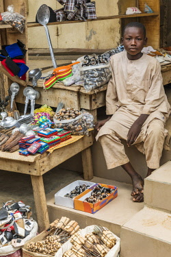 NGR1183 Nigeria, Kano State, Kano. A young boy mans his father's general shop in the sprawling 15th century Kurmi market.