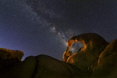 US05BJY1167 USA, California, Alabama Hills. Milky Way and lit Cyclops Arch