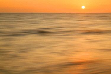 US10AJE0645 Long exposure of waves at sunset, Boca Grande, Florida.