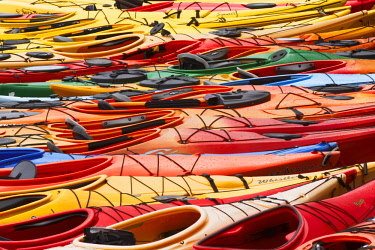 US22AJE0097 Large pattern of sea kayaks, Rockport Harbor, Massachusetts, fish house.