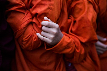MYA2432 Myanmar, Bagan. The hands of young monks lining up to receive alms at the Ananda Festival.