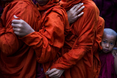 MYA2433 Myanmar, Bagan. The hands of young monks lining up to receive alms at the Ananda Festival.