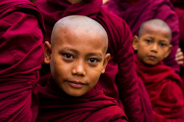 MYA2434 Myanmar, Bagan. Young novice monks lining up to receive alms at the Ananda Festival.