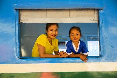 MYA2413 Myanmar, Yangon. A mother and daughter on the Yangon Circular Railway.