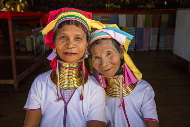 MYA2377 Myanmar, Inle Lake. Padaung ladies wearing their heavy brass coiled rings around their necks.