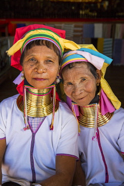 MYA2378 Myanmar, Inle Lake. Padaung ladies wearing their heavy brass coiled rings around their necks.