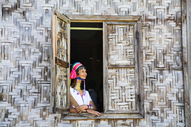 MYA2379 Myanmar, Inle Lake. Padaung lady wearing her heavy brass coiled rings around her neck.