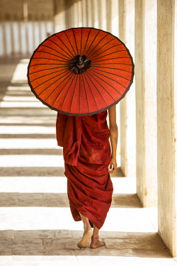 MYA2333 Myanmar, Bagan. A novice monk walking in the corridors of Shwezigon Paya.