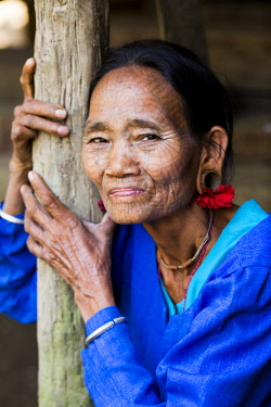 MYA2323 Myanmar, Mrauk U. A lady of the Chin people with traditional tattooed face, in a small village up river from Mrauk U.